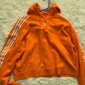 Bright orange adidas cropped hoodie